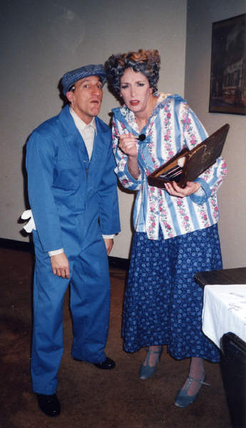 Singing in the Rain, one of the numerous characters, Carousel Dinner theater 2001