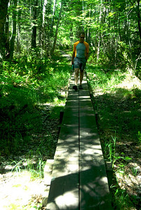 Tony on the trail from our campsite to the light house on Sand Island. The trail was covered almost entirely two miles each way with these boardwalks.