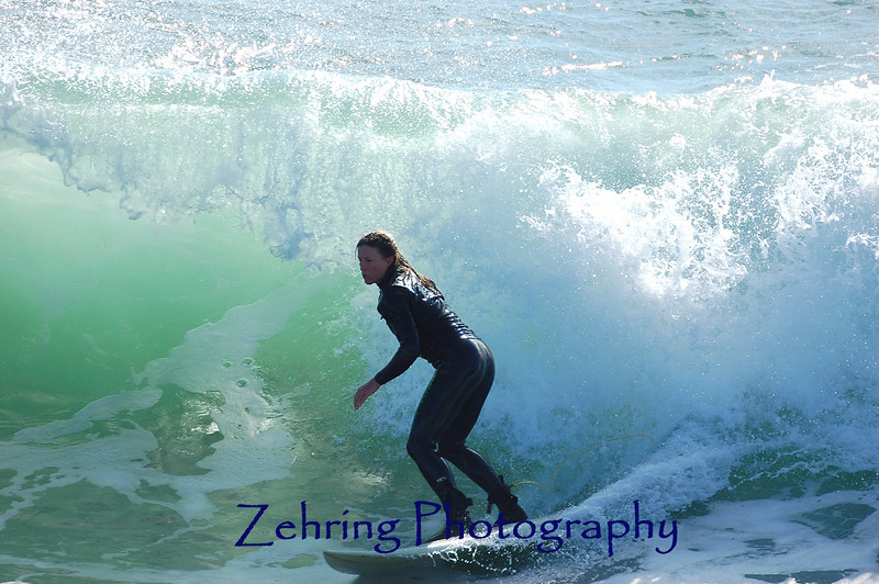 An out-of-towner catching a good ride on a wave near a popular California hot spot.