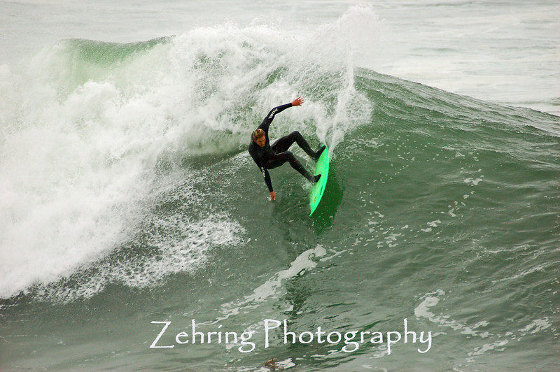 "Female surfer getting a decent ride at ""Steamers"" Santa Cruz, California."