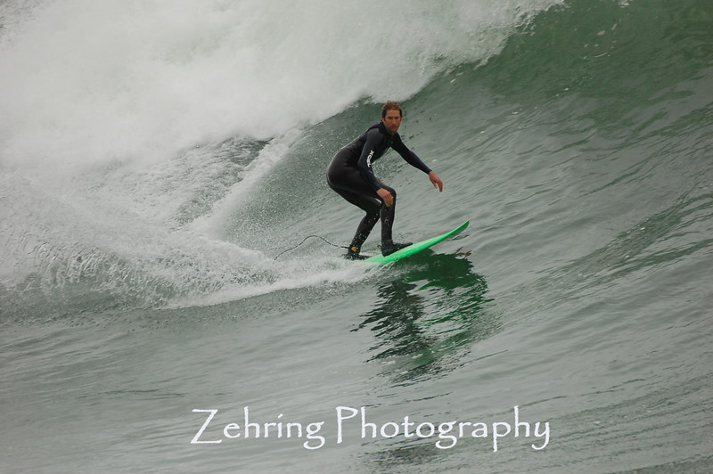 "Making the most of a good ""set"" on some nice waves at ""Steamers""."