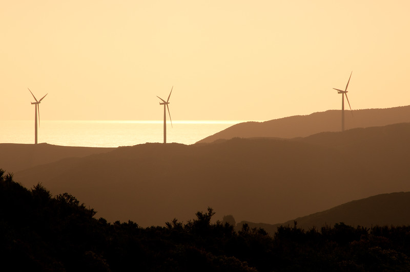 Wind Energy turbines in the sunset, from Karori, Wellington, New Zealand, December 2010. [Karori 2012-12 003 Wellington-NZ]