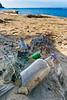 Dangerous trash on the beach at Base G, near Jayapura, Papua, Indonesia, June 2018.
