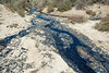 Crude oil leaking out into a dried watercourse, not far above McKittrick Oilfields on Highway 58, west of Buttonwillow, California, USA, June 2015. [McKittrick-HWY58 2015-06 004 CA-USA]