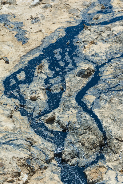 Crude oil leaking out into a dried watercourse, not far above McKittrick Oilfields on Highway 58, west of Buttonwillow, California, USA, June 2015. [McKittrick-HWY58 2015-06 007 CA-USA]
