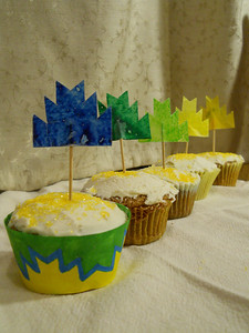 Finalist #5 I was inspired to use traditional Native American designs in a modern way!  I used leftover crayon bits melted between wax paper to create the translucent cupcake toppers and markers on paper to create the cupcake wrapper.