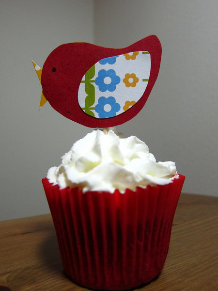 Finalist #10 Hi - my entry is a birdcage cupcake holder made made with scrapbook paper.  I'm always do cupcakes for my kids' parties and in the spirit of spring, thought of the birdcage idea to hold the cupcake topped with a bird topper.  (They can be scaled for mini cupcakes too.)