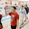 Don Knight / The Herald Bulletin<br /> Anderson's Hannah Boerner walks to her starting position followed by Pendleton Heights' Madison Brand for the 500 yard freestyle final during swimming sectional action at Fishers High School on Saturday.