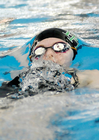 Don Knight / The Herald Bulletin<br /> Pendleton Heights' Rebekah Monnier competes in the 100 yard backstroke consolation heat during the swimming sectional finals at Fishers High School on Saturday.