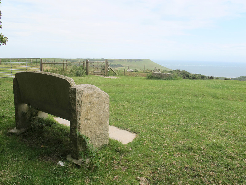 The Memorial Bench watches over Encombe House (below in the valley) and Houns-tout cliffs beyond.