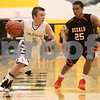 Kyle Bursaw – kbursaw@shawmedia.com<br /> <br /> Sycamore's Jacob Winters moves to the basket as DeKalb's Rudy Lopez covers him in the first quarter of the game at Sycamore High School on Friday, Feb. 22, 2013.