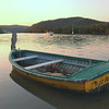 Woywoy. A modern tupperware boat passing abandoned craftsmanship