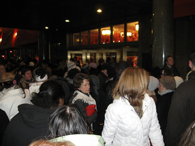 The crowd on the sidewalk at Macy's.
