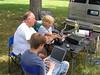 Milt helps Adam tune; Tyler logging. Mark Joseph photo.