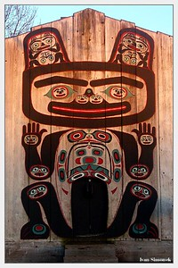 """SUNSET AT SHAKES ISLAND"", Tlingit tribal house entrance illuminated by setting sun.Wrangell, Alaska, USA.-----""ZAPAD SLUNCE NA OSTRUVKU SHAKES"", vchod do kmenoveho domu Tlingitu ozareny zapadajicim sluncem."
