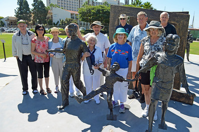 A dozen Village Members at the Bronze Statues, celebrating Cancer Cures