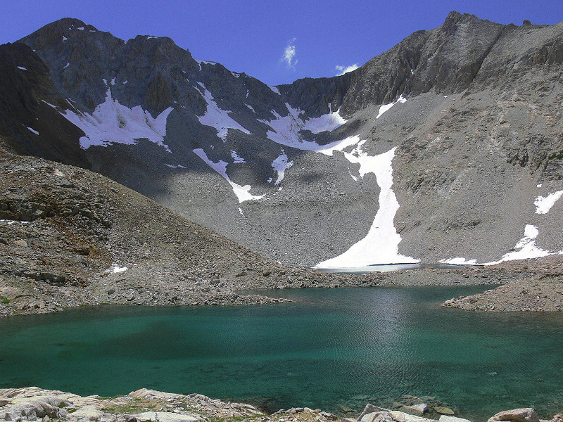 This is one of the unnamed lakes on the way to Pinchot Pass; I liked the azure-green color and the cloud shadow on the mountain.  The elevation on this part of the trail is around 11,200 feet.