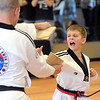 Pat Christman<br /> Tanner Winkler breaks a board held by his father Colby during testing for his second degree black belt Saturday at Lee's Champion Tae Kwon Do in Mankato.
