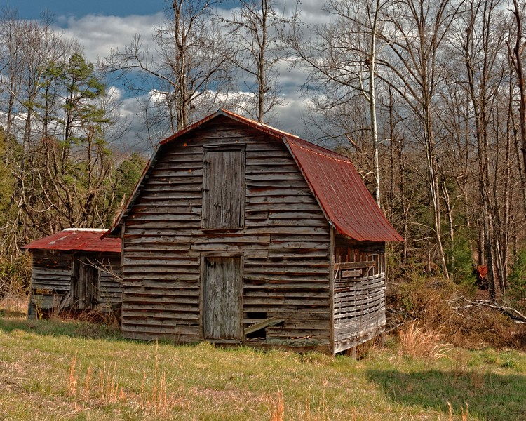 One of several outbuildings and barns