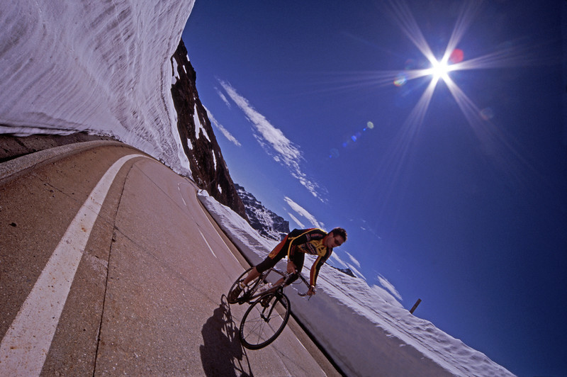 Swiss mountains in winter, road cyclist