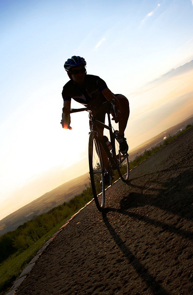 Road cyclist at sunset