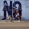 Havana, Cuba. Cyclist passes no ALCA sign