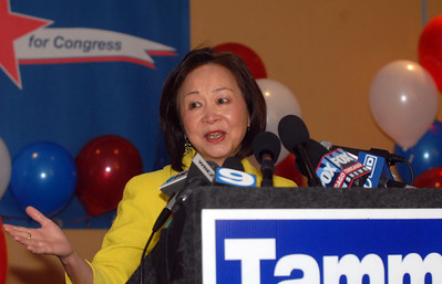Tammy Duckworth spokeswoman Nancy Chen discusses how Tammy has influenced the Asian American communities during election night Tuesday November 6, 2012. Tammy is running against Joe Walsh in the 8th Congressional District. Staff photo by Erica Benson