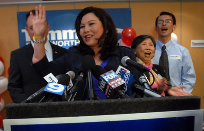 Tammy Duckworth is surrounded by her husband Bryan Bowlsbey, mother Lamai Duckworth and brother Tom Duckworth as she gives her speech to  the 8th Congressional District during election night Tuesday November 6, 2012.  Staff photo by Erica Benson