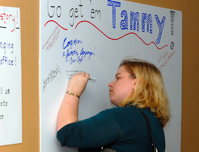 Tammy Duckworth supporter Erin Hoffmeier of Schaumburg writes words of encouragement during election night Tuesday November 6, 2012. Tammy is running against Joe Walsh in the 8th Congressional District. Staff photo by Erica Benson