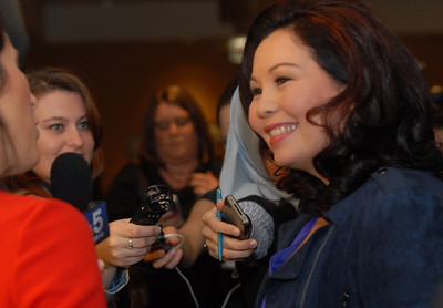 Tammy Duckworth is approached by media during election night Tuesday November 6, 2012. Tammy is running against Joe Walsh in the 8th Congressional District. Staff photo by Erica Benson