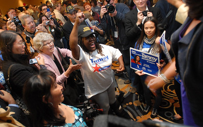 Tammy Duckworth is surrounded by supporters including Octavia Mitchell of Chicago after she gives her speech to the 8th Congressional District during election night Tuesday November 6, 2012.  Staff photo by Erica Benson