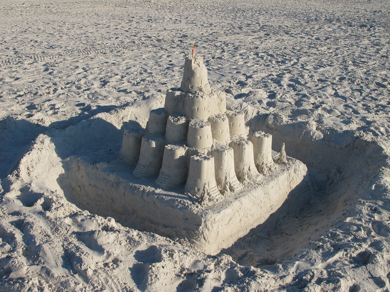 Sand castle.  Note the miniature pine trees along the right front.  A bobber used for the spire on top.