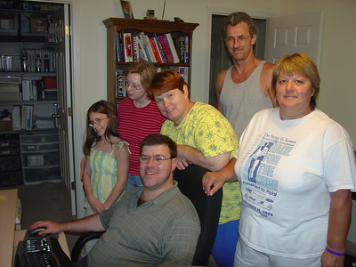 Dave and Connie's master computer room at 543 Forest Trail in Montgomey July 2005. Dave Jr at the controls while Meagan, Lorie, Connie, Glen and Debbie look on.