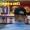 Man with tattoos on his neck at Phuket airport in Thailand in August 2017