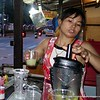 Woman making a smoothie at a street food stall in Bangkok, Thailand in August 2017