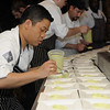 Arnold Myint (Top Chef Season 7) places avocado mousse on plates for the hundreds of guests awaiting.
