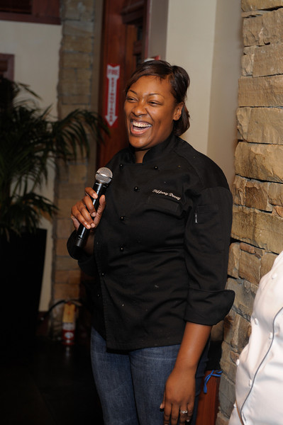Bravo's Top Chef Contestant Tiffany Derry (Season 7 & 8) is all smiles for her guests as she explains the dish she has prepared.