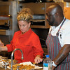 Bravo Television's Top Chef contestants Andrea Curto-Randazzo and Kenny Gilbert prepare delicious dishes for a packed house.