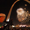 Capturing a fireworks display through the Gateway Arch.