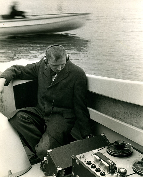 "Albert Bussen recording outboard boat motor sounds on a ""portable"" Ampex 350 reel-to-reel.  The recordings were used in a radio commercial demonstrating the quietness of a boat manufacturer's motors. (Photo courtesy of Albert Bussen.)"