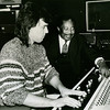 "Audio engineer Mike Radentz at the mixing board of Technisonic Studios with world famous gospel singer and preacher Rev. Cleophus Robinson, Sr. (circa 1989).  The recording featured an orchestra and choir of 30+.  Mike emphasizes the haircut is NOT a mullet; ""We called that haircut a 'bi-level' back then.""  (Photo from the Technisonic archive.)"
