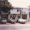 Engineer's Book Store on North Avenue, 1970s.  Before Junior's expanded to take up the whole storefront, and before Engineer's Book Store moved near the corner of North Avenue and Luckie Street. Note barbed wire fence on the right to keep Techwood inmates from escaping.