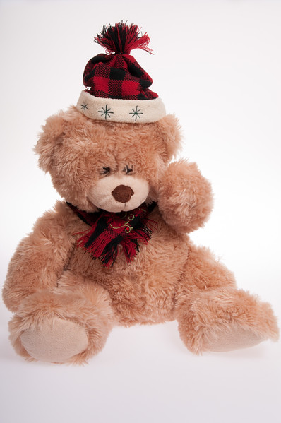 Christmas teddy bear with hat and scarf isolated on white background
