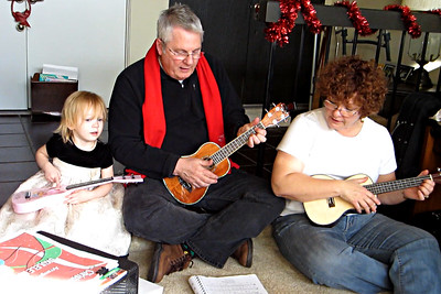 Terry and Rich playing their banjos on December 18th, 2011 at Willie's house in Oxnard.  Ashley accompanying on her guitar.
