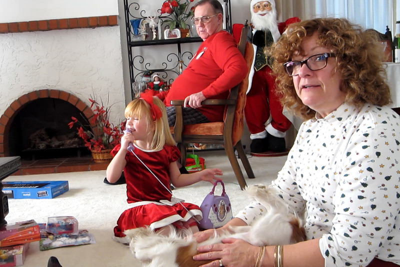 Terry with Teddy and singing Christmas songs. Ashley is singing with her new microphone
