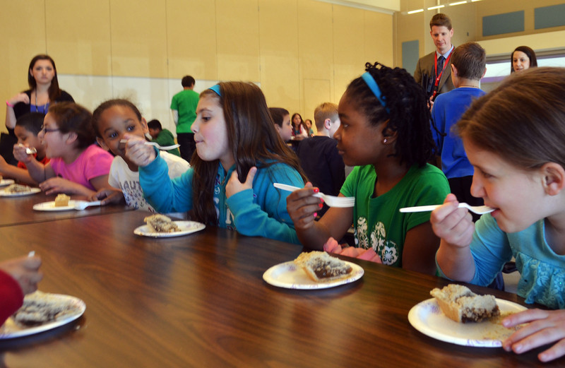 McDonald Elementary School third graders sample shoofly pie.   Friday,  April 24, 2014.   Photo by Geoff Patton