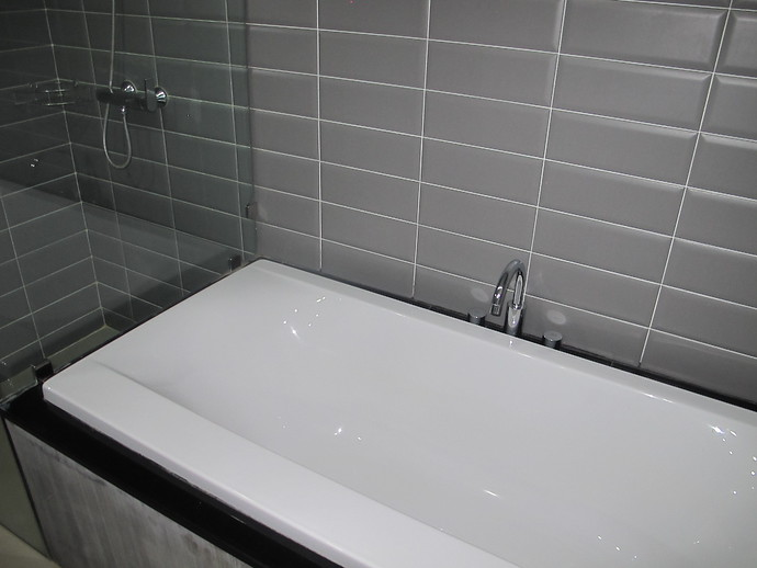 Shower cubicle and bath tub