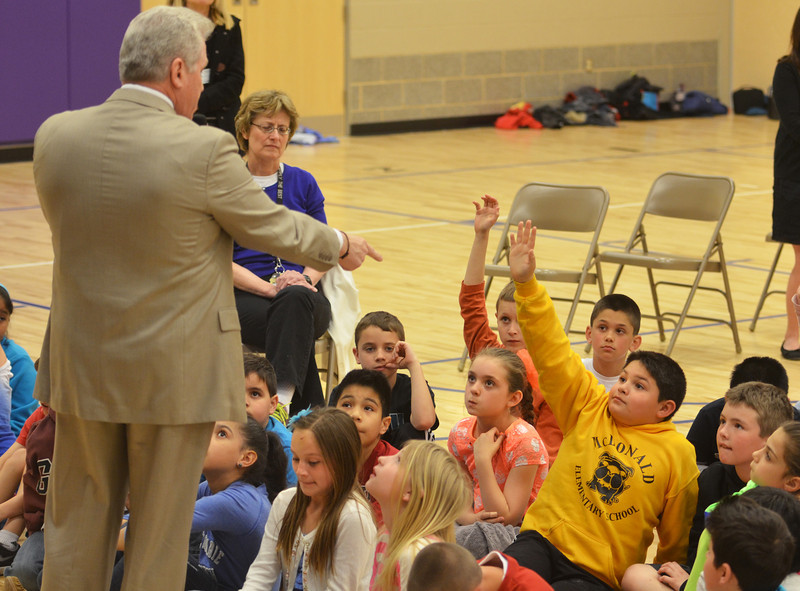 State Representative Bernie O'Neill calls on a third grader with a question during a visit to McDonald Elementary School.   Thursday,  April 24, 2014.   Photo by Geoff Patton