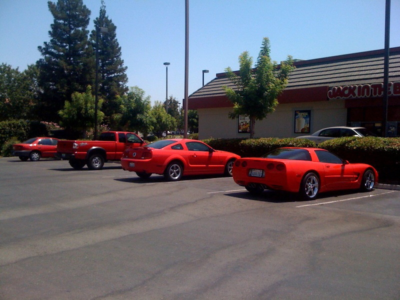My Red S-10 & 3 other Red Vehicles all in this one section of the parking lot and no other cars present.