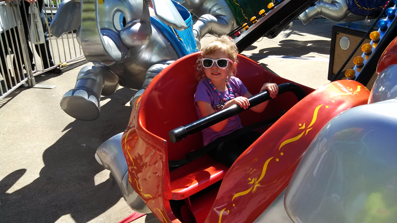 Laney rides the flying elephant ride